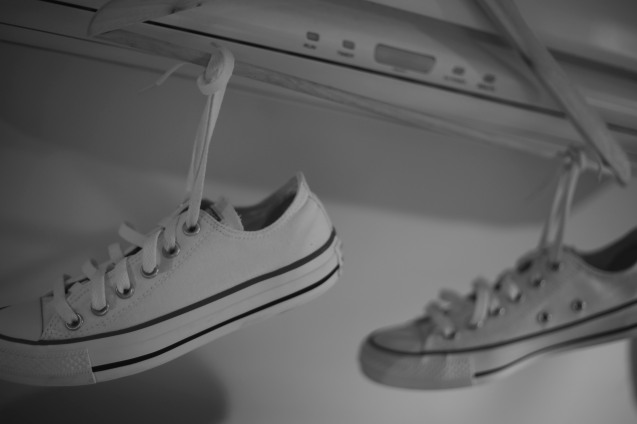 Hanging Converse shoes to dry